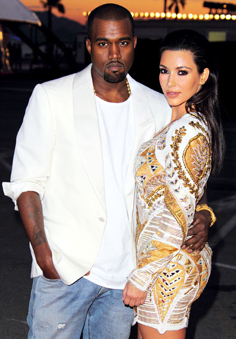 "Kanye West and Kim Kardashian attend the ""Cruel Summer"" presentation during 65th Annual Cannes Film Festival on May 23, 2012. Credit: Mike Marsland/WireImage.com"