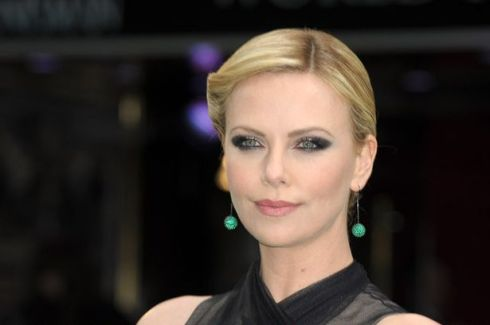 Charlize does a bit of bewitching with her eyes